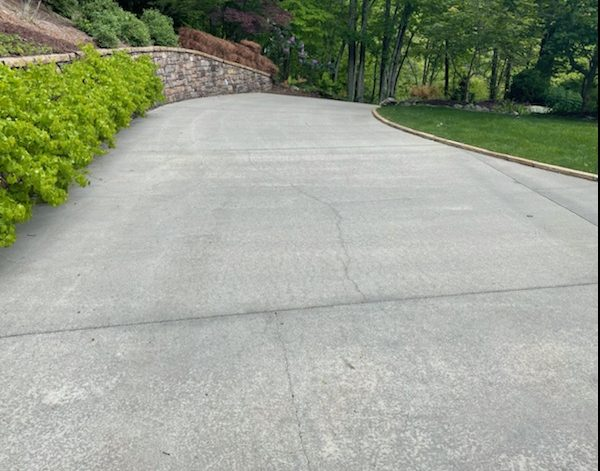 clean driveway after pressure wash
